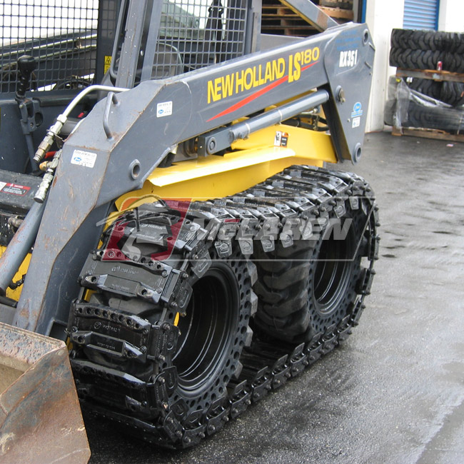 Set of McLaren Magnum Over-The-Tire Tracks for Komatsu SK 1020