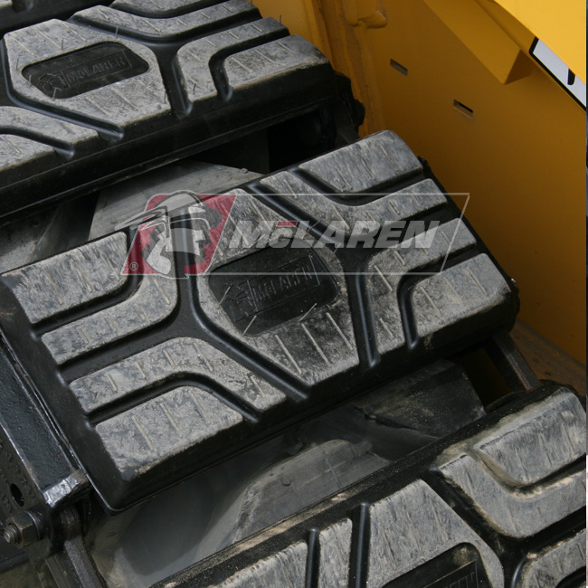 Set of McLaren Rubber Over-The-Tire Tracks for Komatsu SK 1026