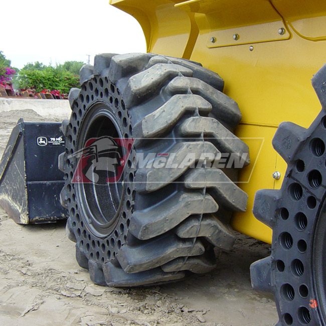 Nu-Air Monster Solid Tires with Flat Proof Cushion Technology with Rim for Caterpillar 416 D 2WD