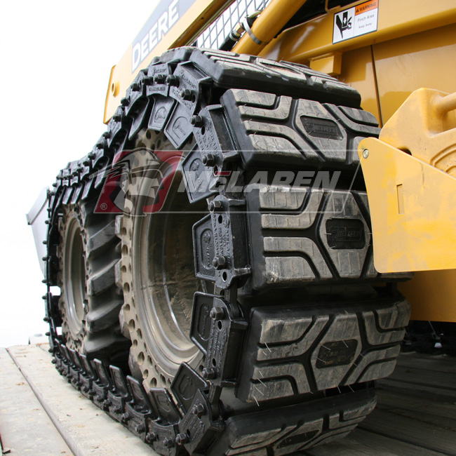 McLaren Rubber Non-Marking orange Over-The-Tire Tracks for Komatsu SK 1026