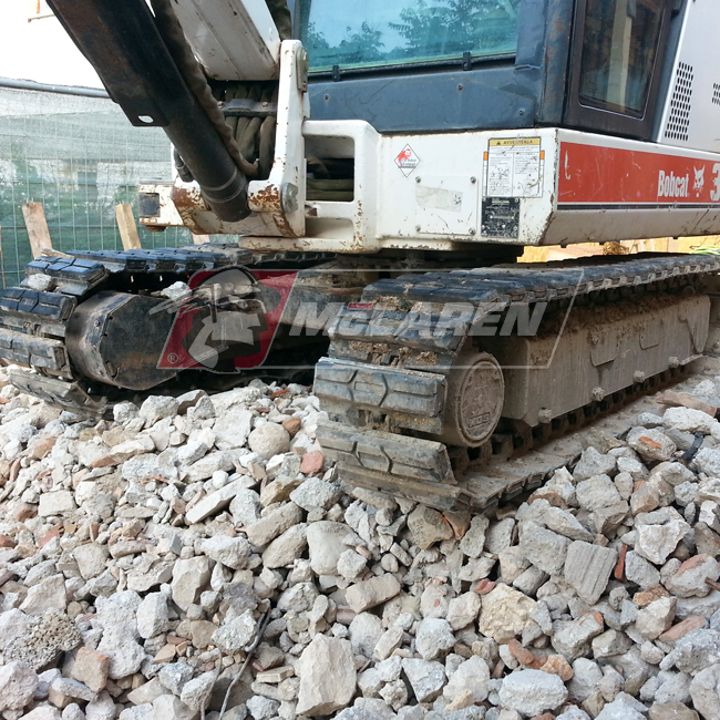 Hybrid Steel Tracks with Bolt-On Rubber Pads for Bobcat E35C